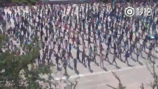 Cool ! Students dance to Michael Jackson during class-break exercise