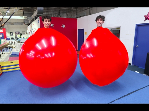 TWINS IN GIANT BALLOONS
