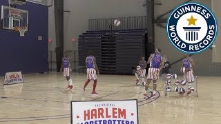 Most behind-the-back basketball three pointers in one minute - Guinness World Records Day 2018