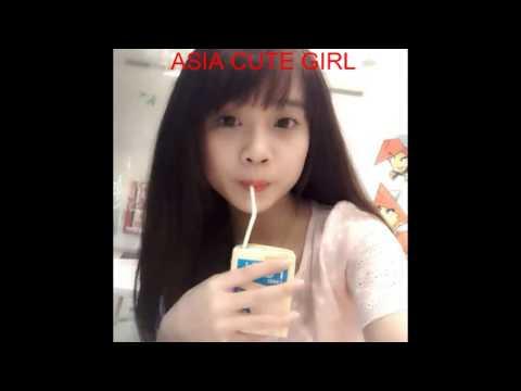 ASIAN CUTE GIRL DRINK MILK