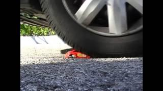 Jennifer crushes a toy car new beetle (slow motion)
