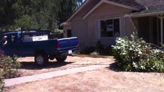 Ford F250 pulls out tree