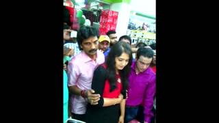 Sanusha  in a shop inaguration with her father