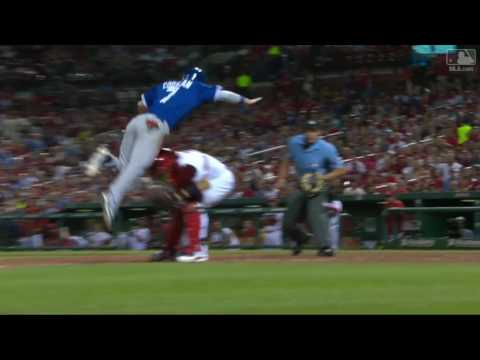 Coghlan leaps over Yadi to score