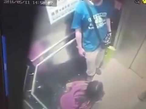 Woman caught on camera taking a quick piss in a Hong Kong elevator