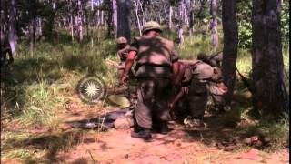 Soldiers check dead soldiers, place them on litter and carry the body off during ...HD Stock Footage