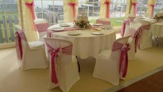 Wedding Chair Covers at the Marquee Wedding Lace and Pink Satin Market Rasen