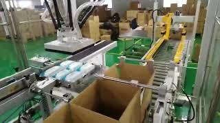 Robotphoenix wet wipe lid applicator and cartoning case packer machine