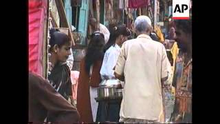 INDIA: BOMBAY: GIRL PROSTITUTES BEING RESCUED BY BROTHEL BUSTERS