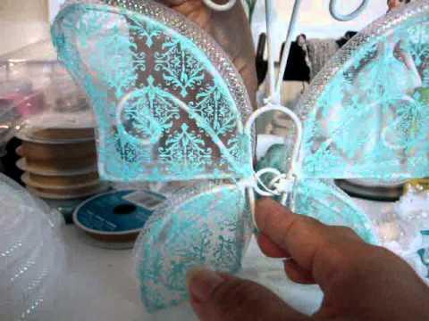 Areglo de mesa para los 15 Años con Mariposa en color Acuazul.77