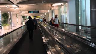 Walking on a travelator at Bangkok airport