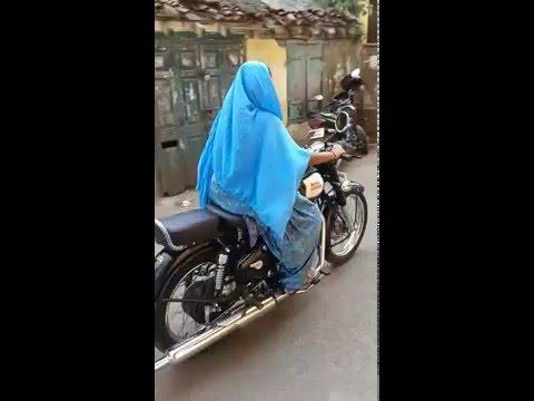 Indian Muslim Girl Driving a bullet