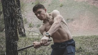 YOUNG MUSCLE BOY SHOWING HIS POWER BY CHOOPING TREES AND FLEXING