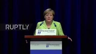 Germany: Merkel backs restarting free trade talks with Washington