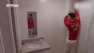 24600 rizne CCTV Footage׃ Chinese athletes fit shower curtain in Olympic Village