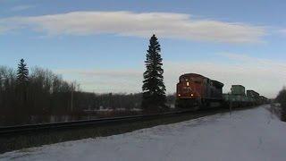 CN Train Spotting: CN 8809 & DPU 2282 Leads CN 102 East Near Uncus AB 3/9 2/28/13