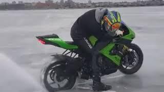 Doing burnout using super bike on ice