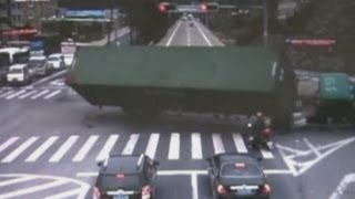 AMAZING VIDEO: Motorcyclist narrowly escapes death as truck overturns in China