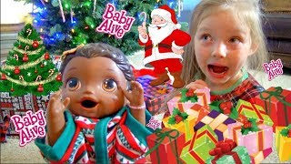 BABY ALIVE has CHRISTMAS MORNING! Lilly catches SANTA! The Lilly and Mommy Show.