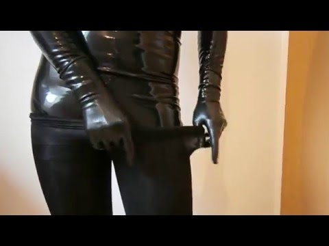 Dressed black pantyhose encasement over latex catsuit