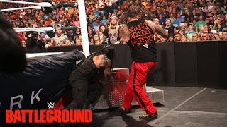 WWE Network: Roman Reigns runs directly into the steel ring steps: WWE Battleground 2015