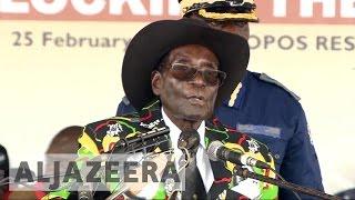 At 93rd birthday bash, Robert Mugabe says he won't quit