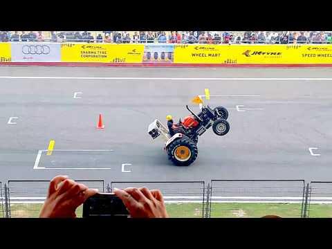 Tractor stunt with racing bike stunt in buddha circuit