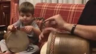 Persian (Iranian) kid is playing  music . Tehran , Iran .