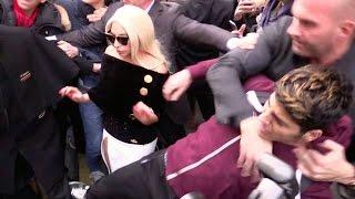 CRAZY FANS ! Lady Gaga hard hotel exit as BODYGUARD FIGHTS a fan in Paris