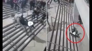 Horse throws policeman off its back and down set of stairs