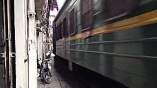 Train Travels Inbetween Houses
