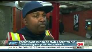 Newspaper takes heat over haunting subway photo
