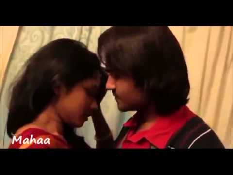 Indian Lovers kissing in home