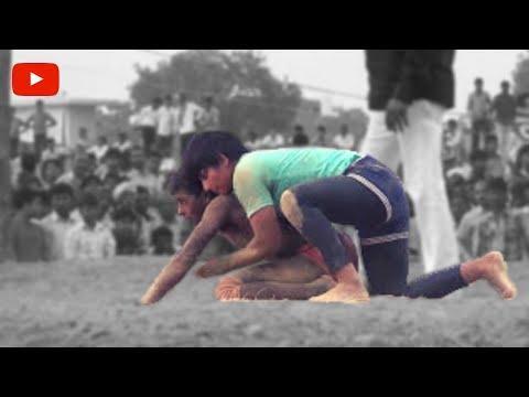 Men vs women :  Traditional indian wrestling , Women pins her male opponent.