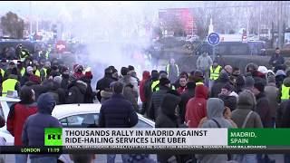 Thousands rally in Madrid against ride-hailing services like Uber