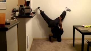 One arm handstand pushup attempts (halfway up)