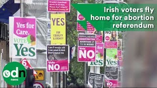 Irish voters fly home for abortion referendum