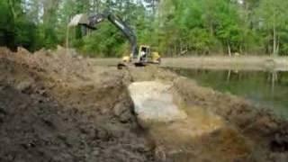 Excavator digging pond