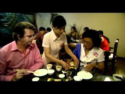 Paul Merton in China eating Donkey penis