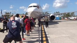 NXT Superstars and Special Olympics athletes pull a plane for Special Olympics Florida