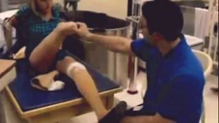 Quad amputee girl at physical therapy