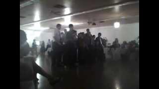 Little boy break dancing to catch garter at wedding