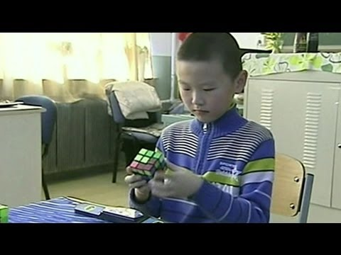 9 YEAR OLD BOY SOLVES RUBIK'S CUBE IN 11.84 SECONDS - BBC NEWS