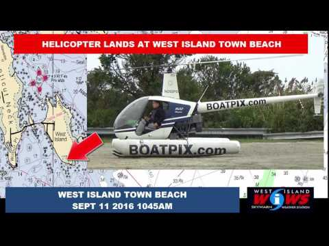 HELICOPTER LANDS UNEXPECTEDLY AT WEST ISLAND TOWN BEACH