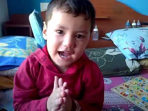 So funny Cute Boy trying to sing Guru Barmha Guru Bishnu...............