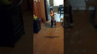 Funny Surprise ending! Cutest kid ever shooting a cup tower with bow and arrow