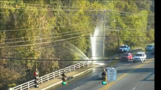 Major water main break on The Plaza at Sugar Creek Road shooting water high in the air, causing traf