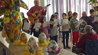 Children Bring a Little Easter-Lilly Joy to a Siena Retirement Home