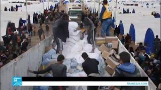 مساعدات إنسانية تصل لنازحي الموصل