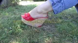 Walking in cork wedges mules